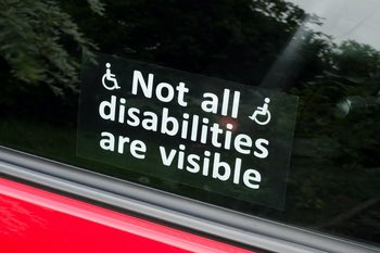 "A sticker on a car window reads ""Not all disabilities are visible"""