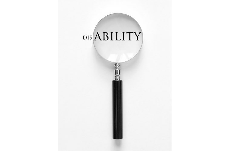 Magnifying glass on the word ABILITY out of disability