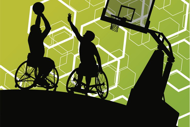 Wheelchair basketballer lines up a shot, while another player tries to block him.