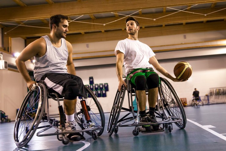 A wheelchair basket baller gets ready to take a challenging shot.