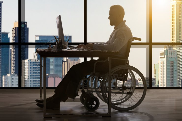 Man working in a sunlit office