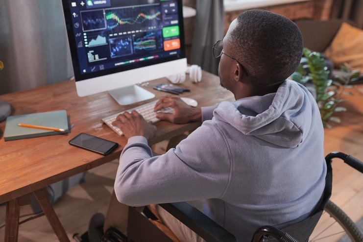 A black man reviewing analytics on a computer