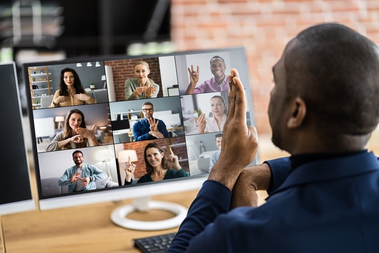 A deaf man in a video conference call with friends and colleagues
