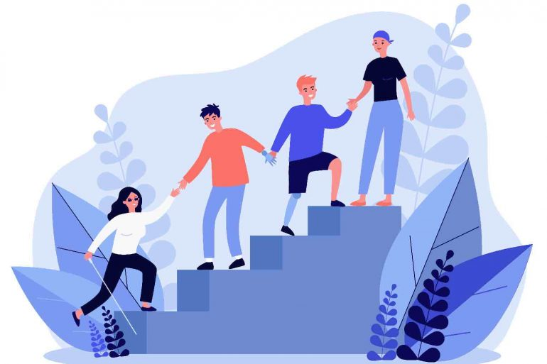 A diverse group of people with a disability helping each other up stairs.