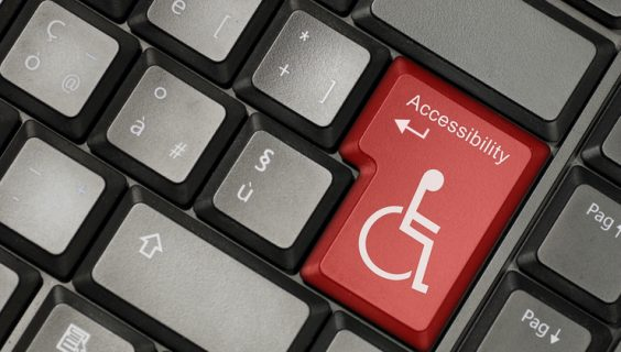 Keyboard, where the enter key has been replaced with a coloured key with the disability icon
